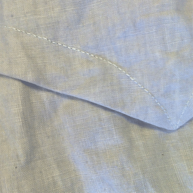 back point detail with hand topstitching
