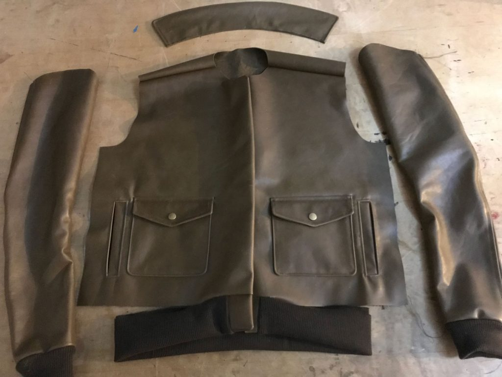 Partially assembled leather flight jacket