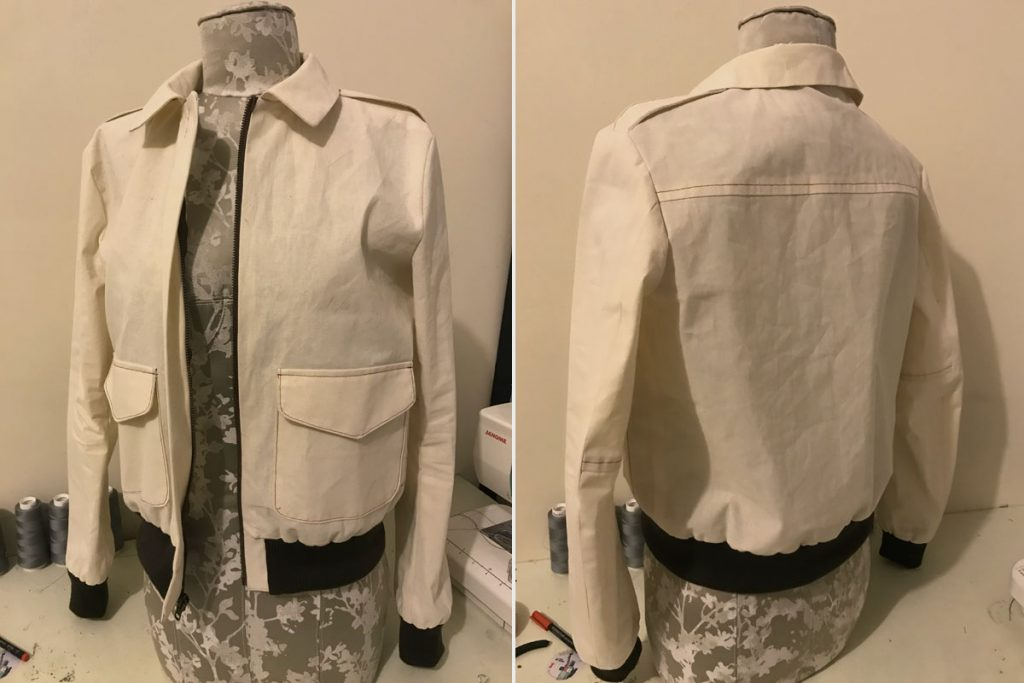 Front and back view of bomber jacket muslin mock-up on tabletop dress form