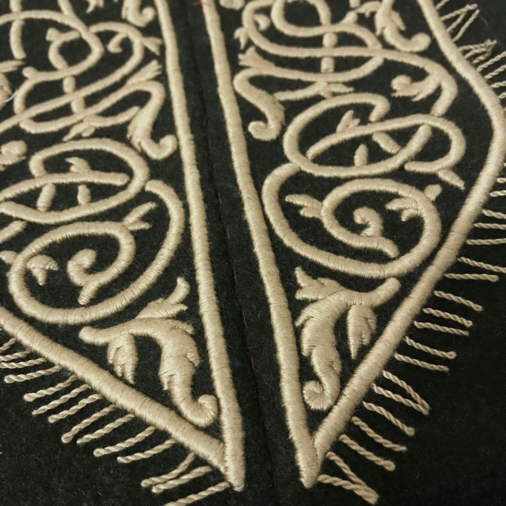 Twisted fringe border added to embroidered panels