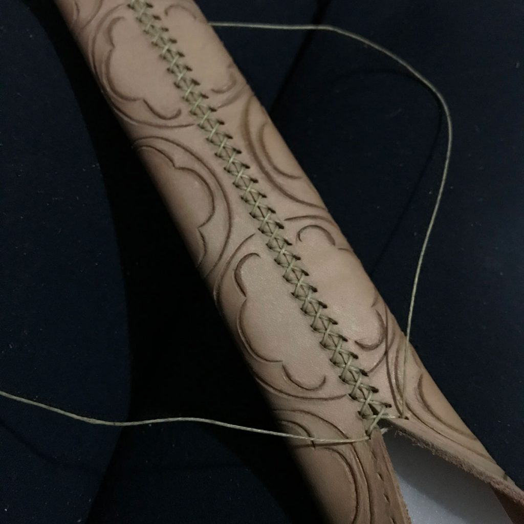 stitching the back seam of the scabbard