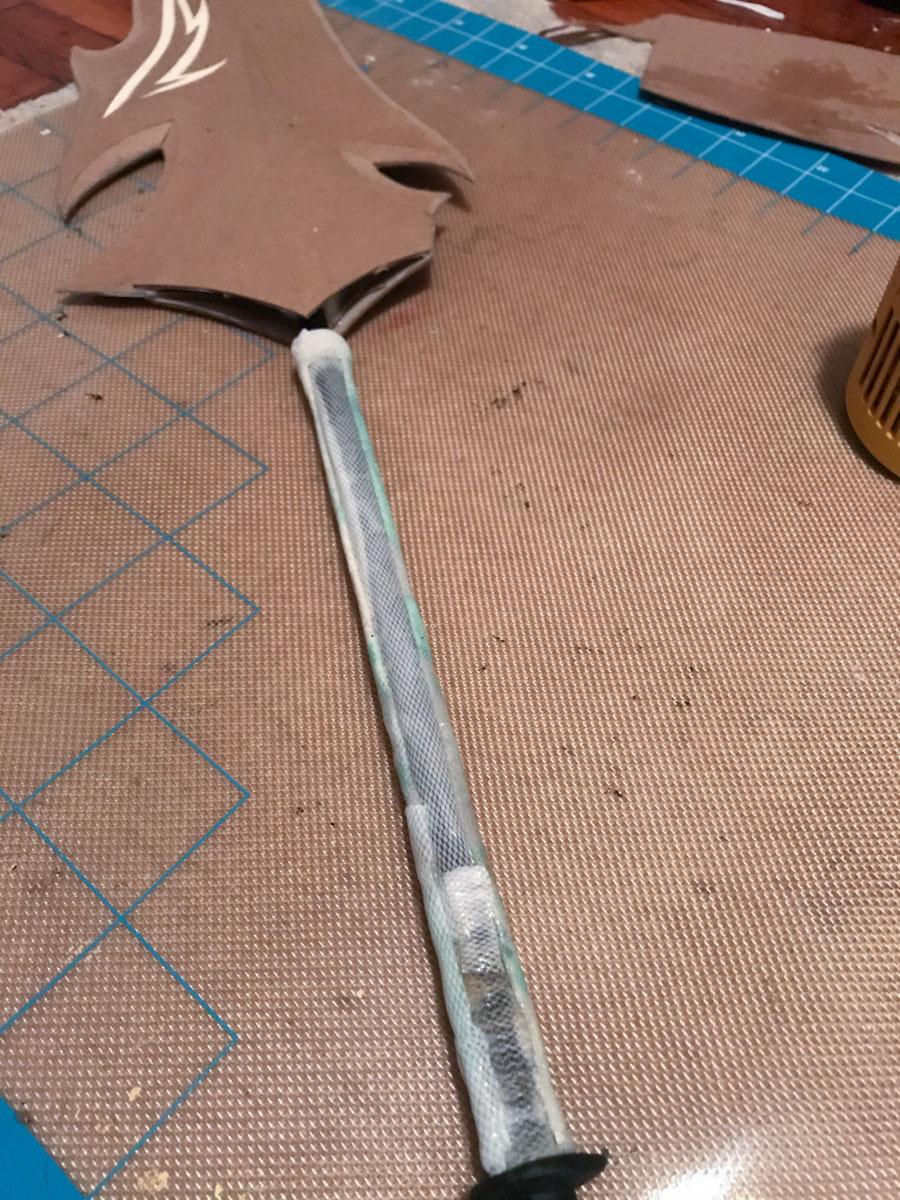 sword hilt wrapped in kobracast scraps