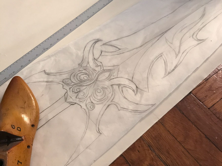 full-size hand-drawn fantasy sword plan on tracing paper