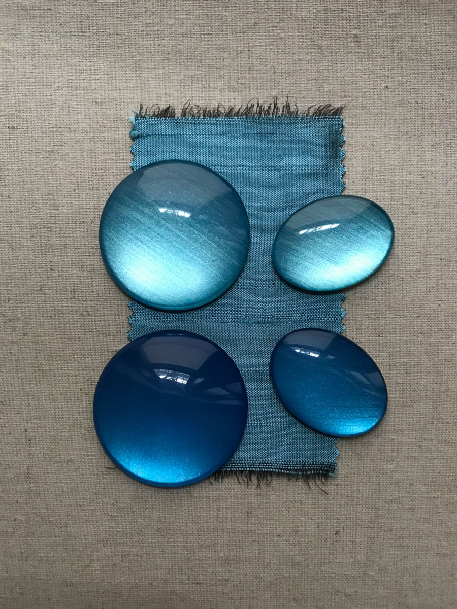 glass cabochons with the backs painted in metallic acrylics, shown with silk swatch