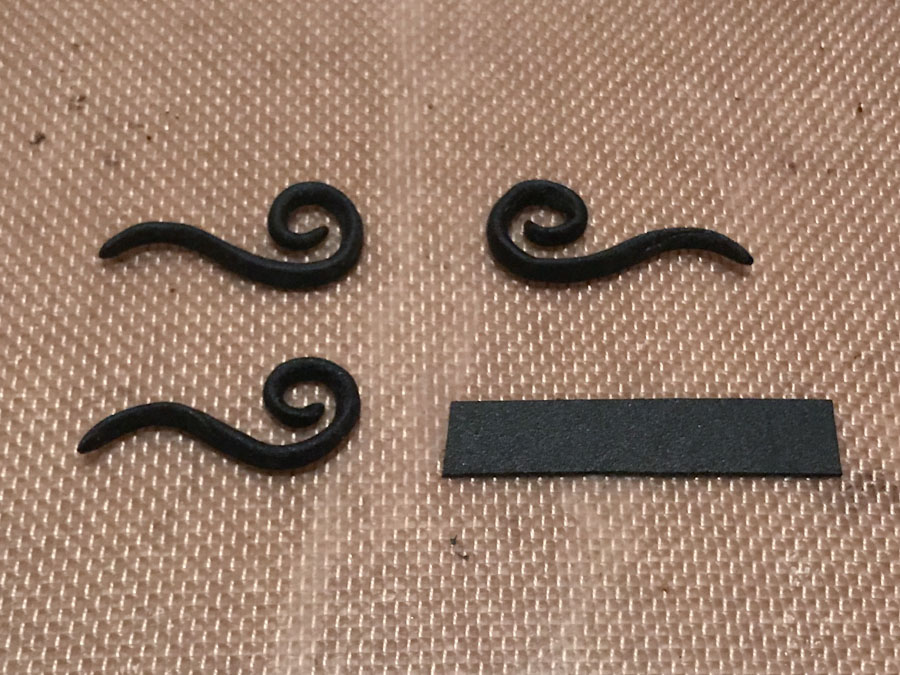 three matching sculpted elements in worbla's black art with material measured out for a fourth