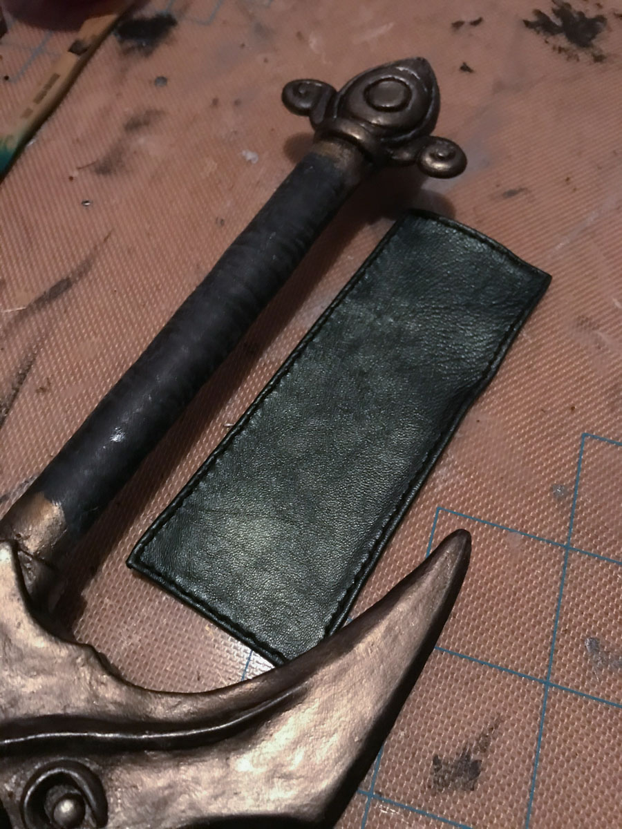 hilt wrap sewn but not yet applied, shown next to sword hilt
