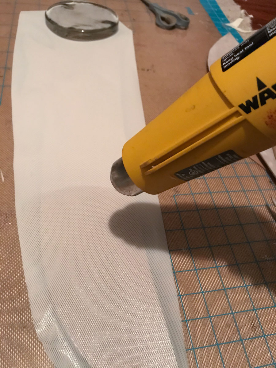 heating worbla's kobracast art on top of cardboard
